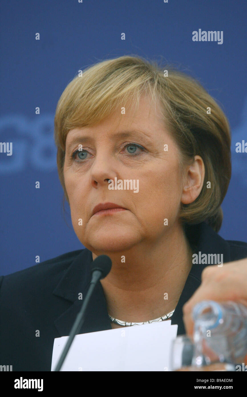German Chancellor Angela Merkel addressing a news briefing in the International Media Center - Stock Image