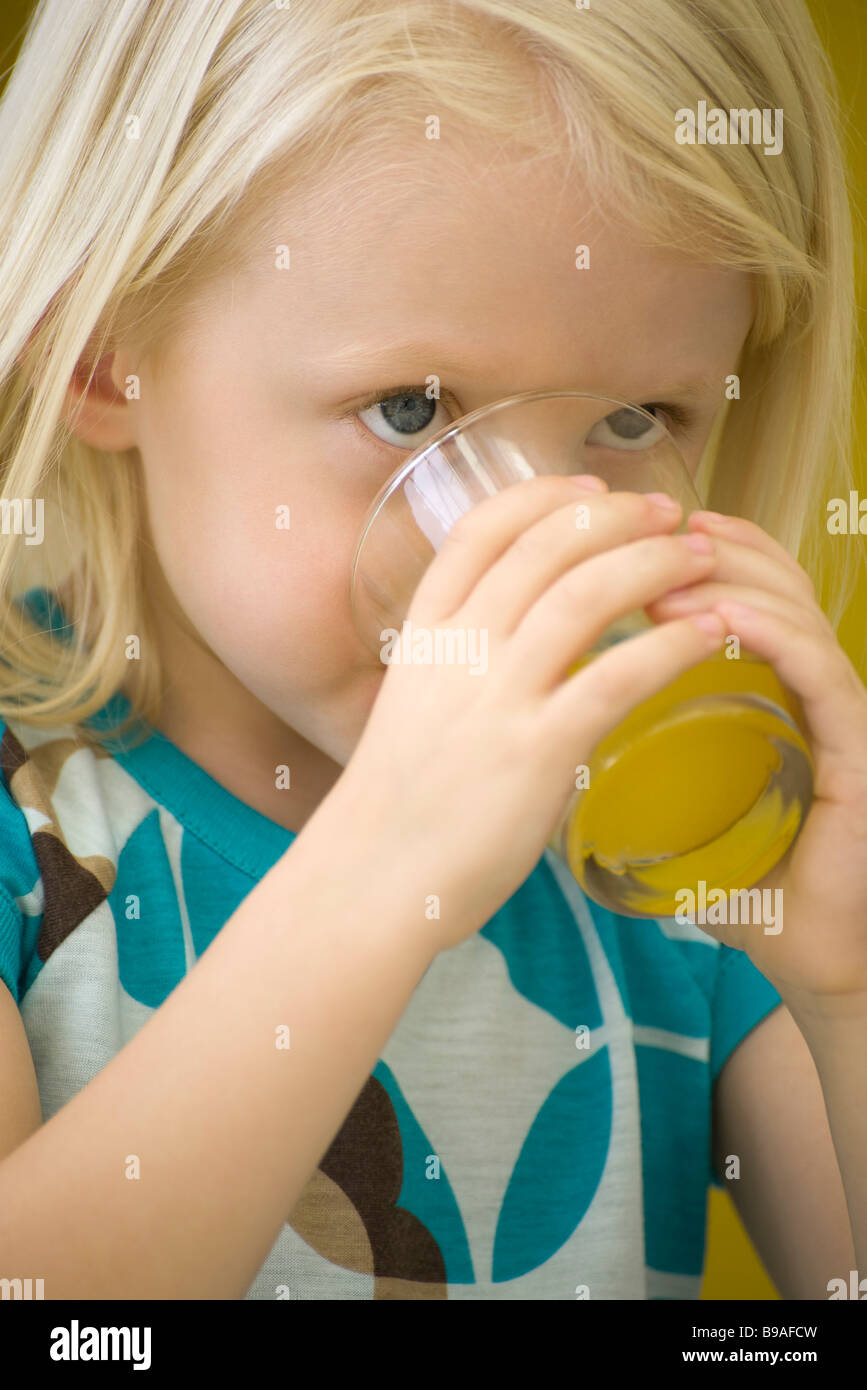 Little girl drinking glass of juice, close-up Stock Photo