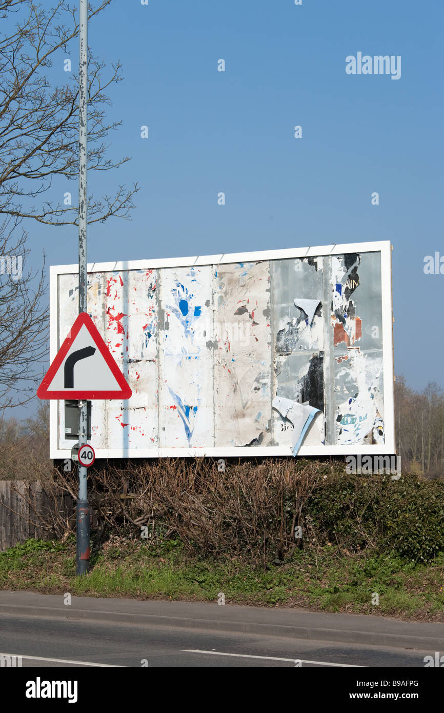 An unused, empty advertising billboard and roadsign in juxtaposition signal a downturn in advertising expenditure - Stock Image