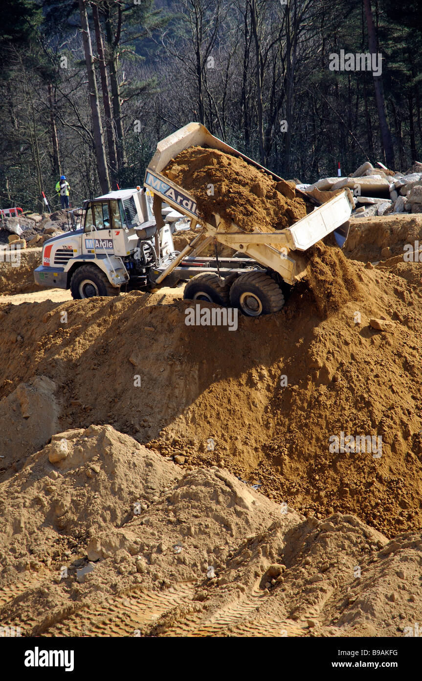 Terex TA30 Articulated truck shifting a load of sand from the construction of twin tunnels on the A3 road at Hindhead - Stock Image