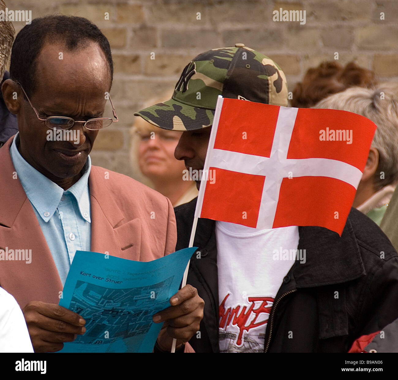 emigrant showing loyalty to his mew country - Stock Image