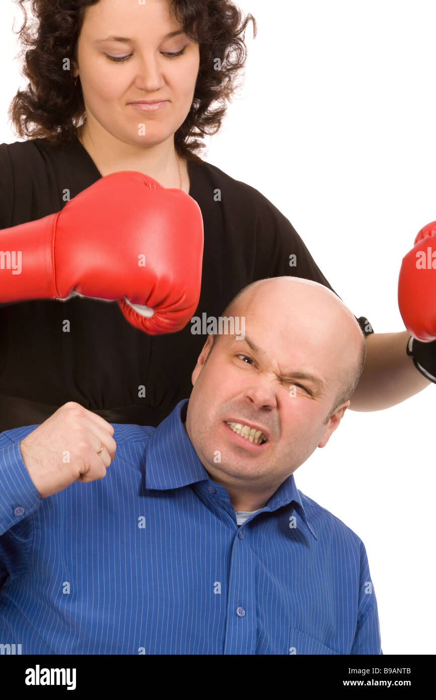 woman with boxing gloves and man on a white background - Stock Image