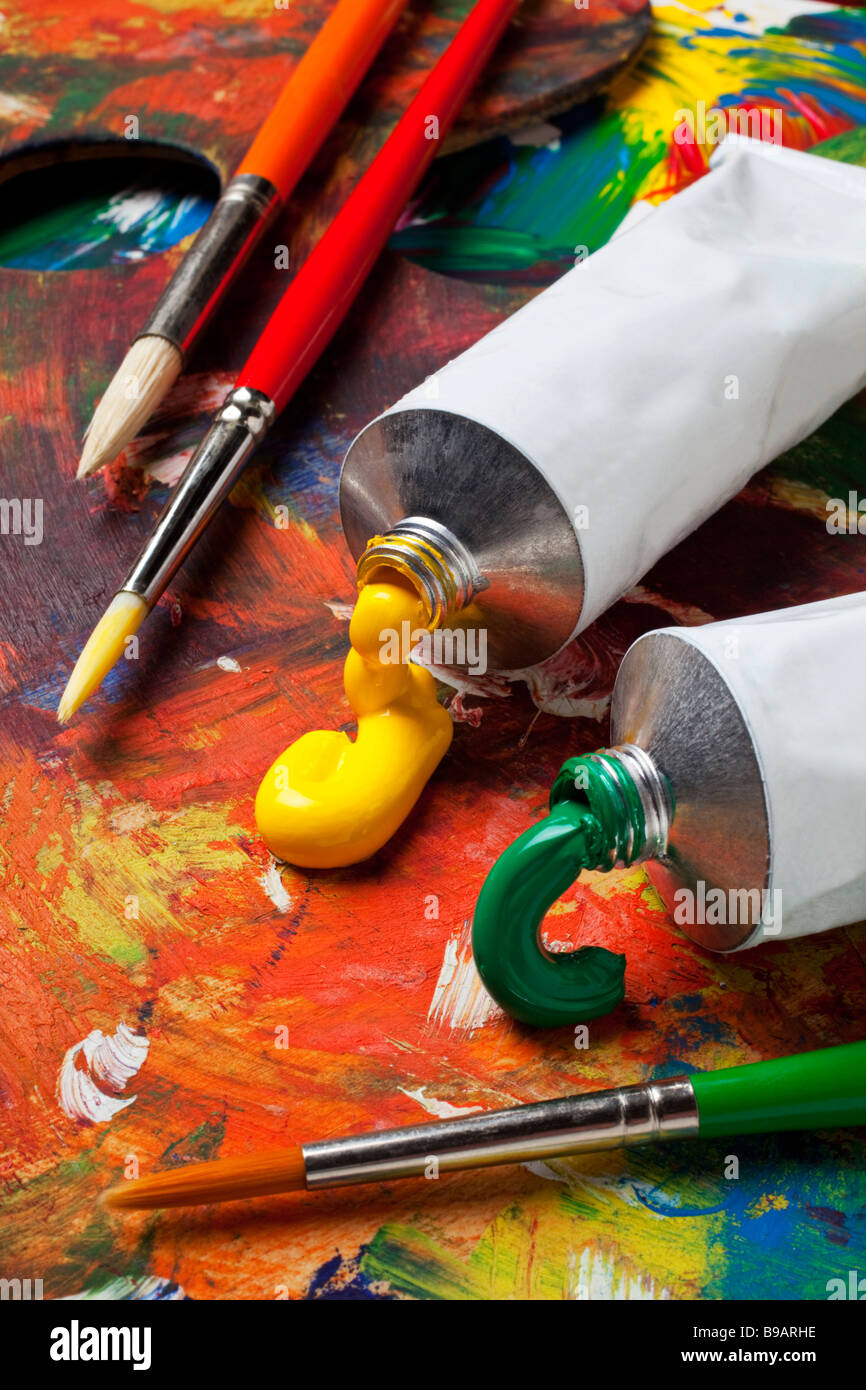 paint tubes and brushes on artist pallet stock photo 22980314 alamy