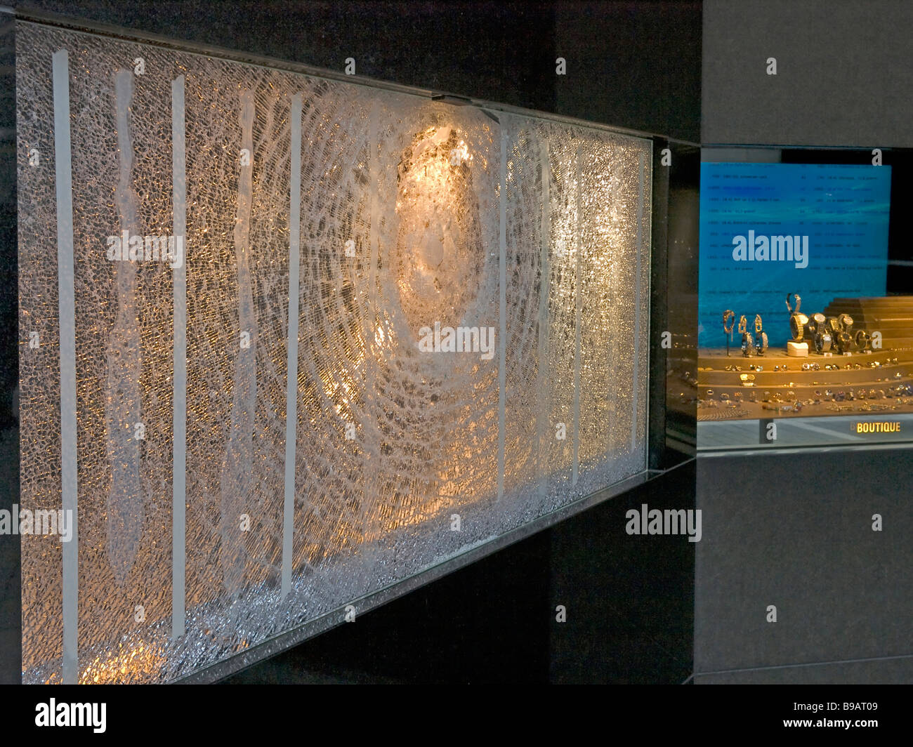burglary wrecked broken glass plates of a display of a jewelry boutique for luxery noble ware and articles in Frankfurt - Stock Image