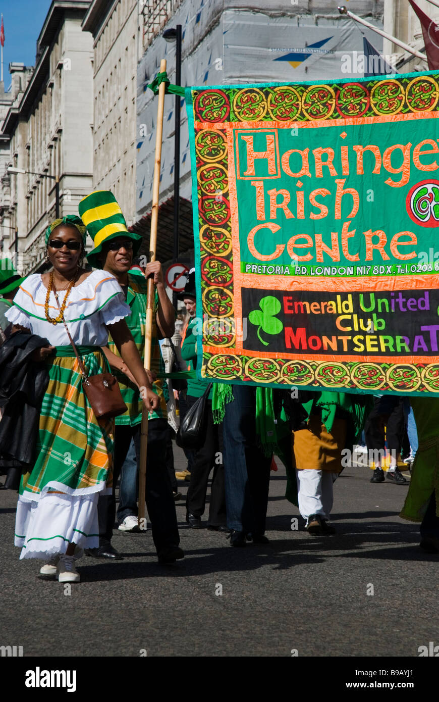 People with Haringey Irish Centre flag at St. Patrick's Day Parade in London England UK, 15th of March 2009 - Stock Image