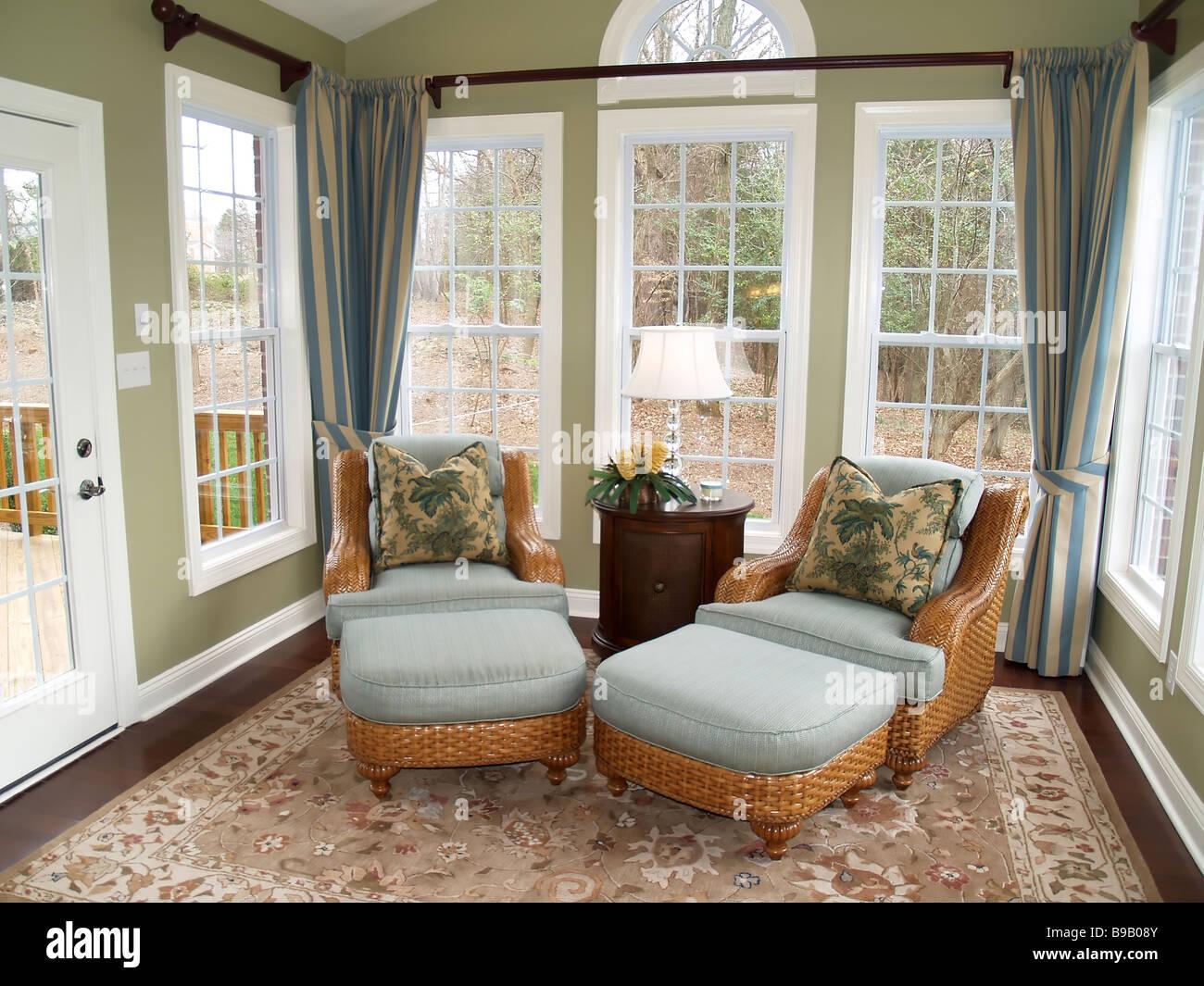 sunroom wicker furniture. Contemporary Sunroom Two Comfortable Rattan Or Wicker Chairs In A Nicely Decorated Luxury Sunroom In Sunroom Wicker Furniture