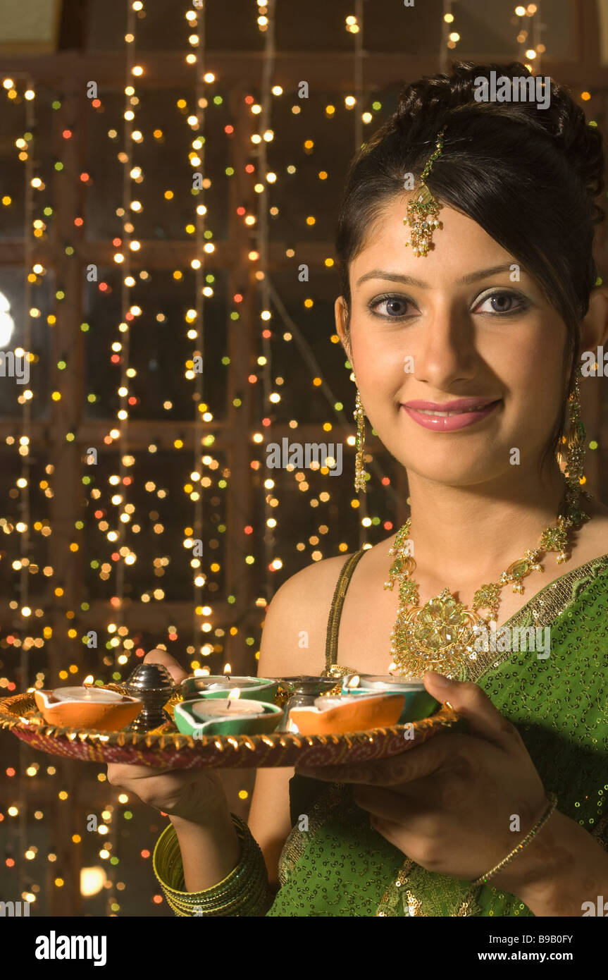 Woman holding a traditional Diwali thali - Stock Image