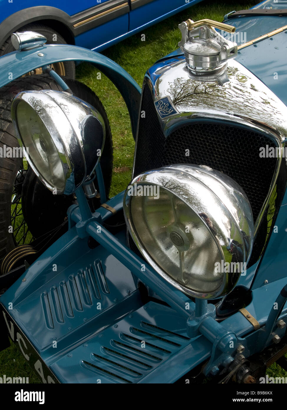 radiator dumb irons and headlamp detail of a vintage Riley car - Stock Image