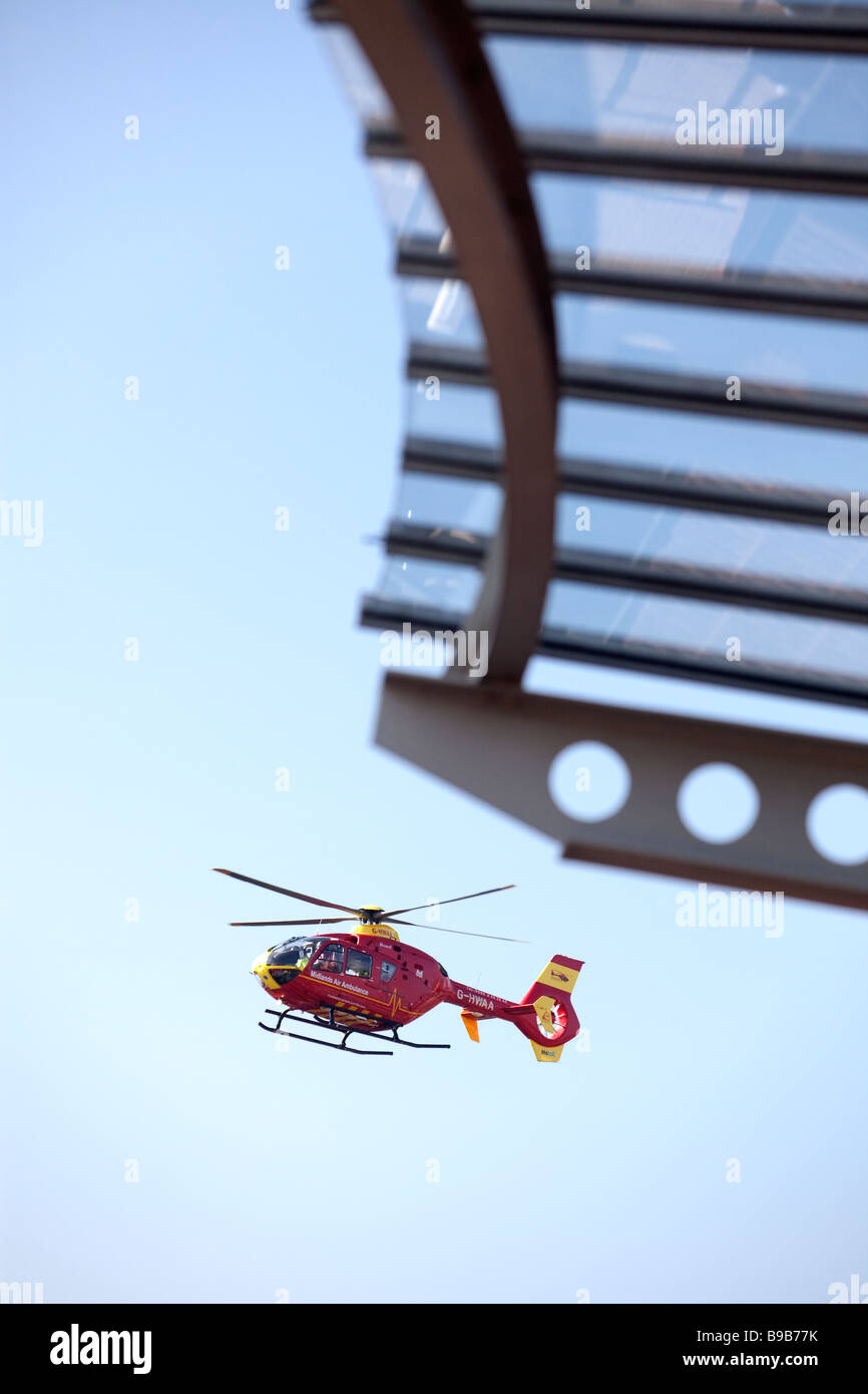 An air ambulance helicopter lands at Selly Oak Hospital Birmingham West Midlands ENgland - Stock Image