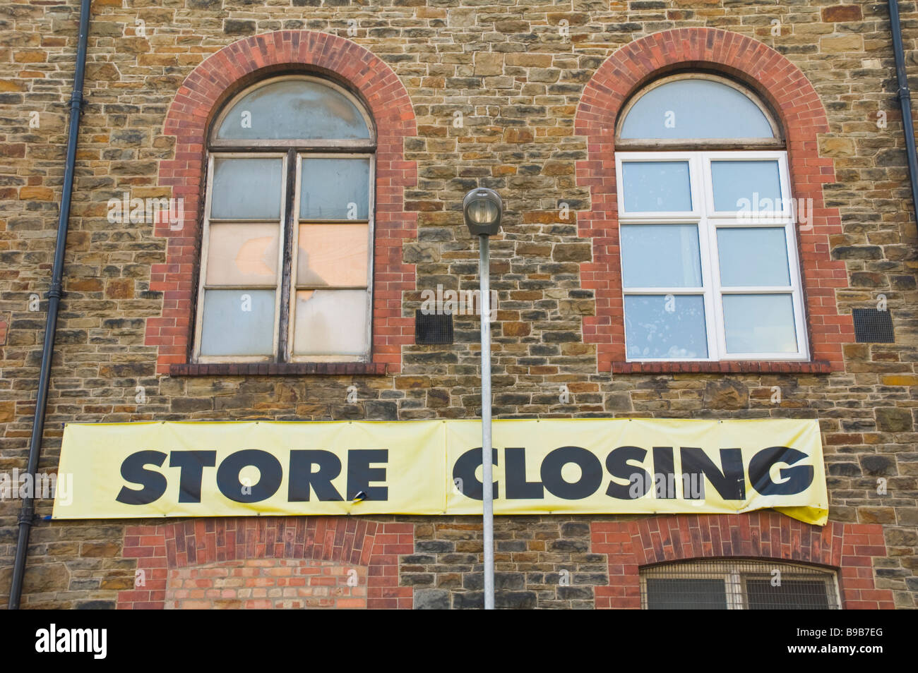 STORE CLOSING banner on wall under windows Newport South Wales UK - Stock Image