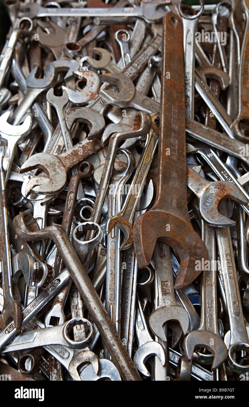 Old used spanners on sale in flea market Wales UK - Stock Image