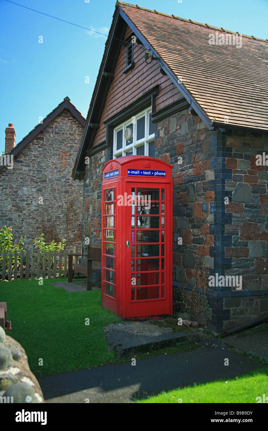 Traditional red telephone box in the village of Allerford, Somerset, England, UK - Stock Image
