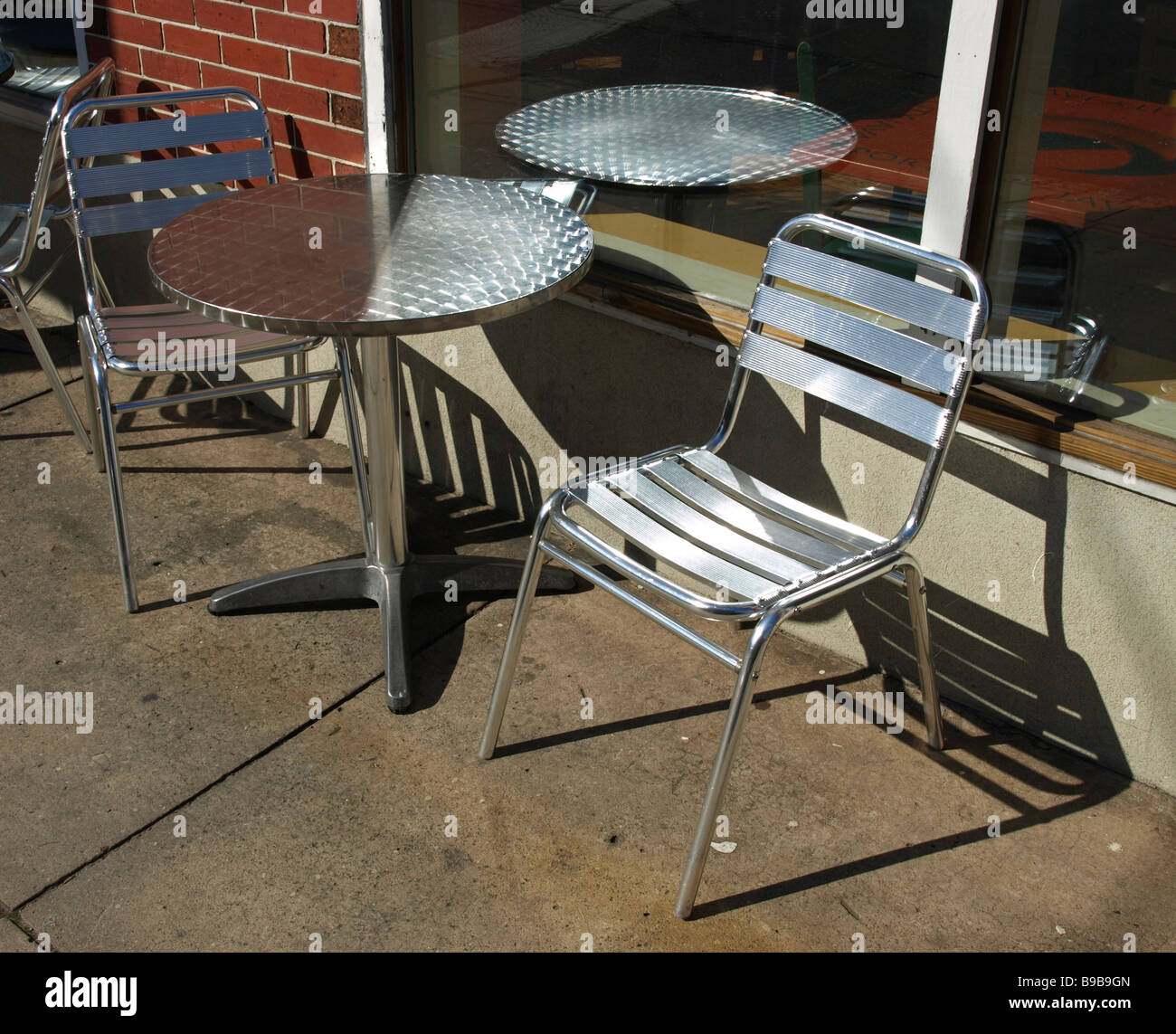 Stupendous Outdoor Metal Table Chairs On Cement Walk Near Brick Wall Uwap Interior Chair Design Uwaporg