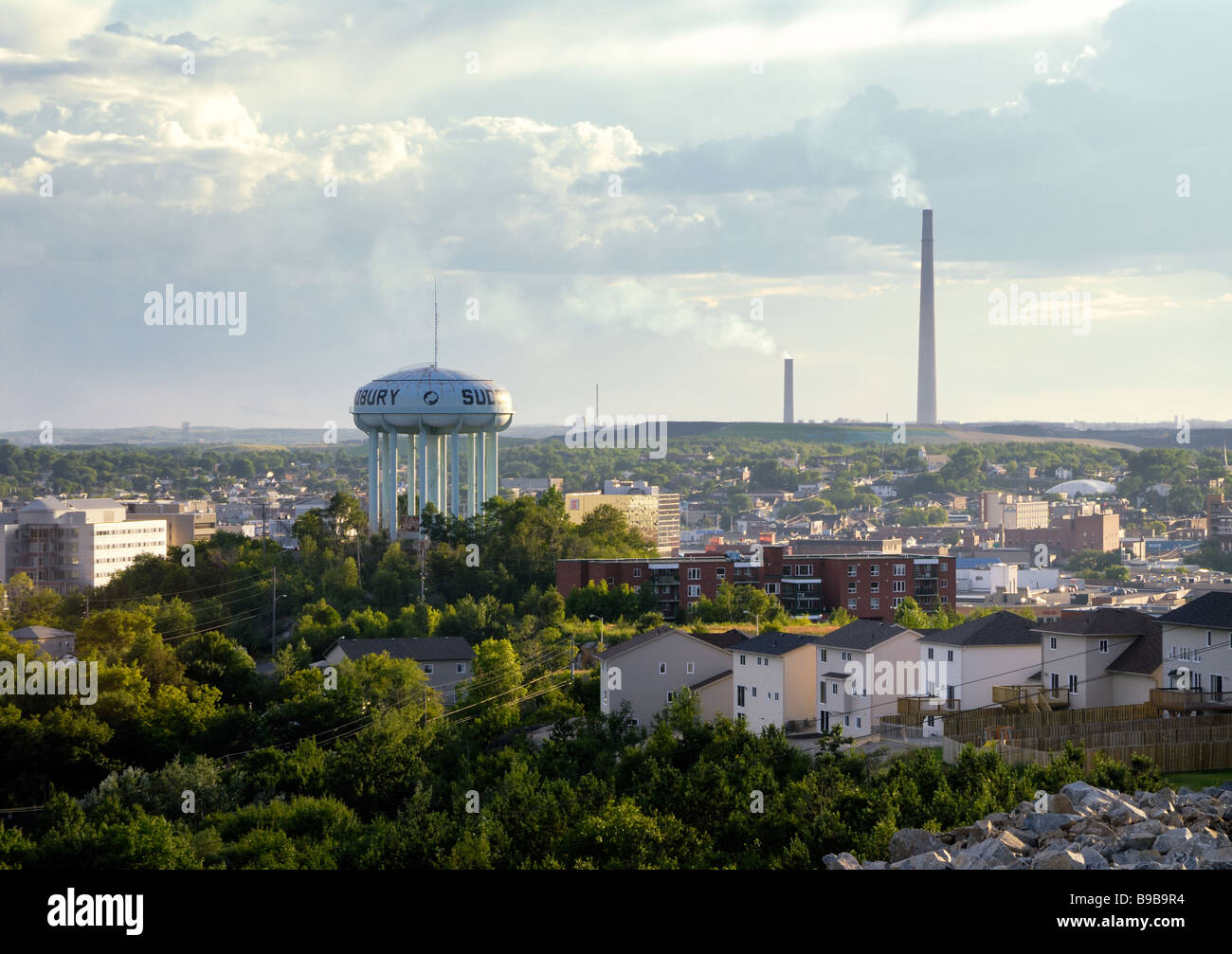 A view of downtown Sudbury, Ontario, with the water tower and superstack in the background - Stock Image