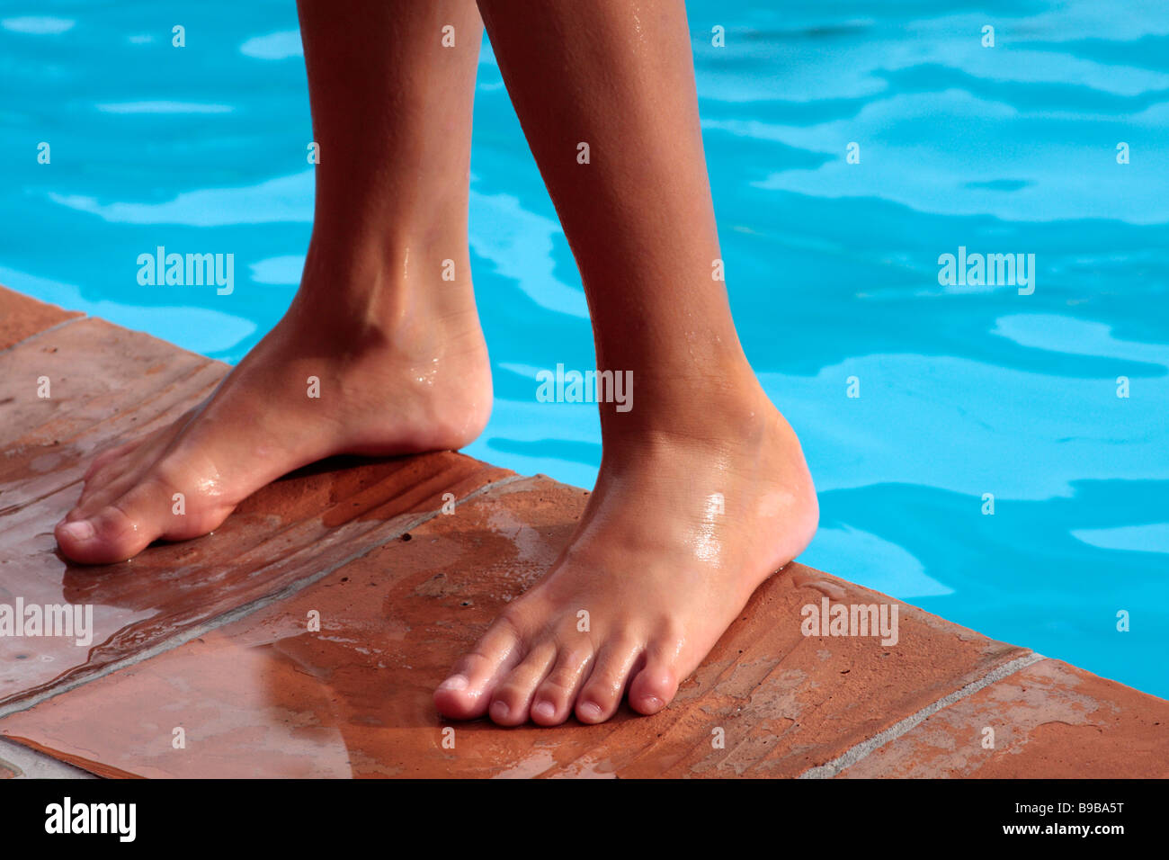 Boys Feet By A Swimming Pool Stock Image