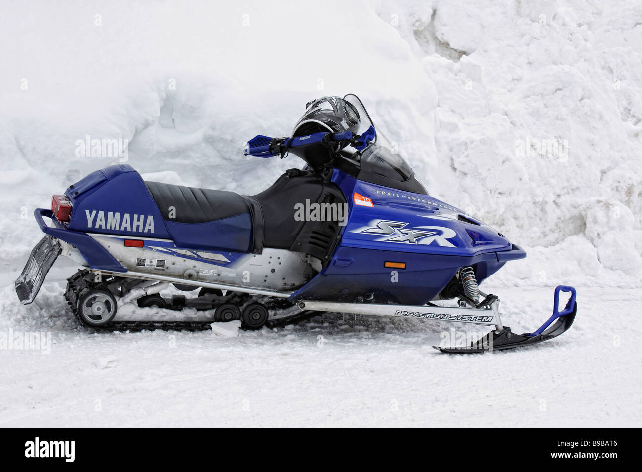 Blue snowmobile on the street in USA - Stock Image
