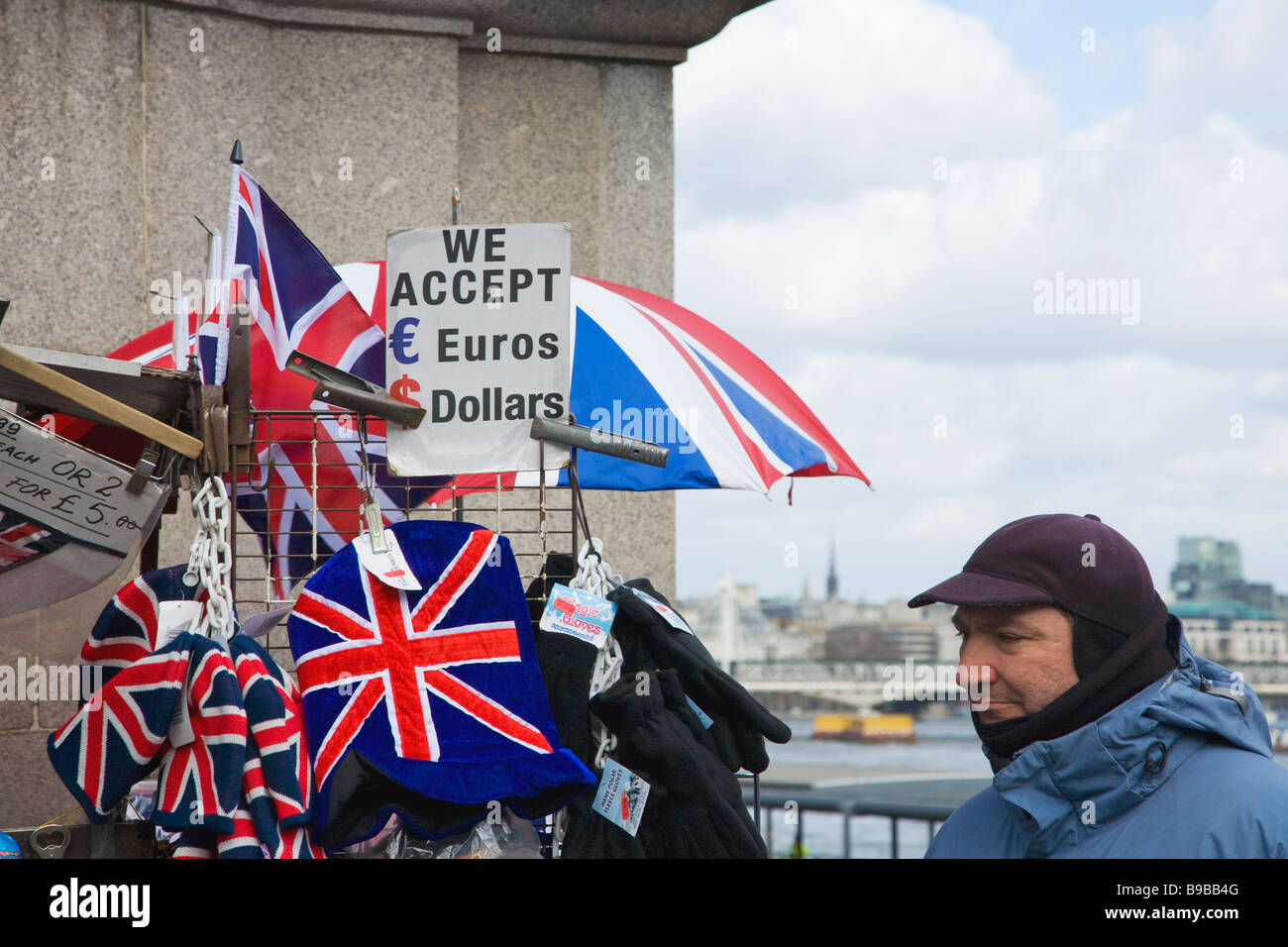 Street Trader selling union jack hats and memorabilia near Westminster Bridge London England Great Britain United - Stock Image