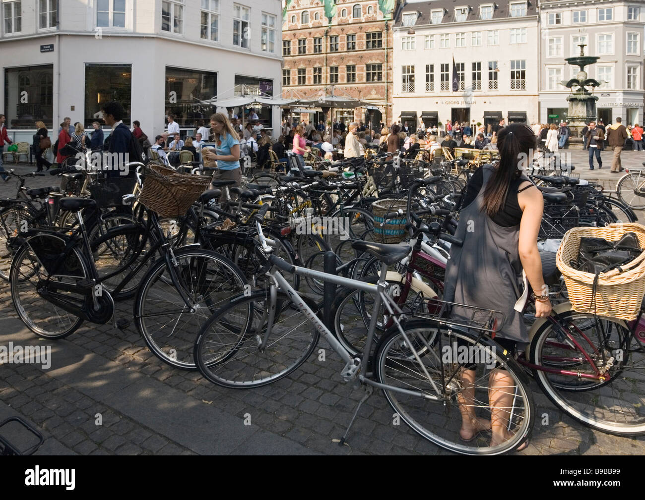 Copenhagen, Denmark. Parked bicycles at Amagertorv square - Stock Image