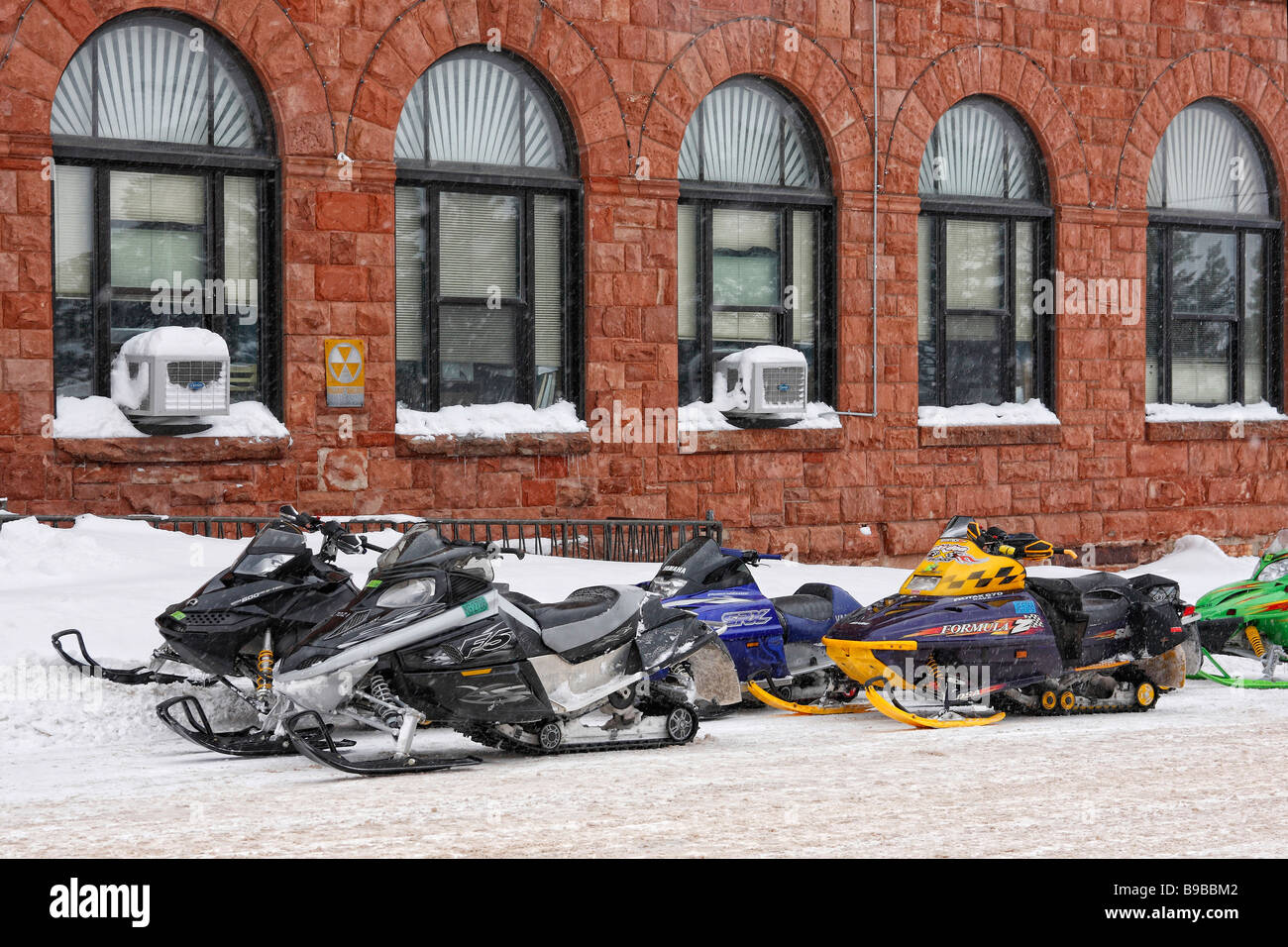 Snowmobiles parked on the street in USA - Stock Image