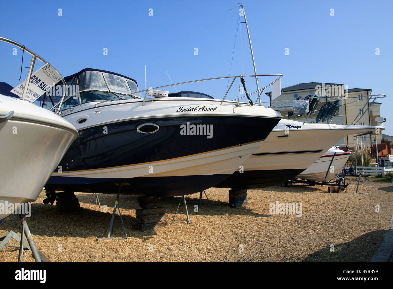 cabin cruisers lined up for sale - Stock Image