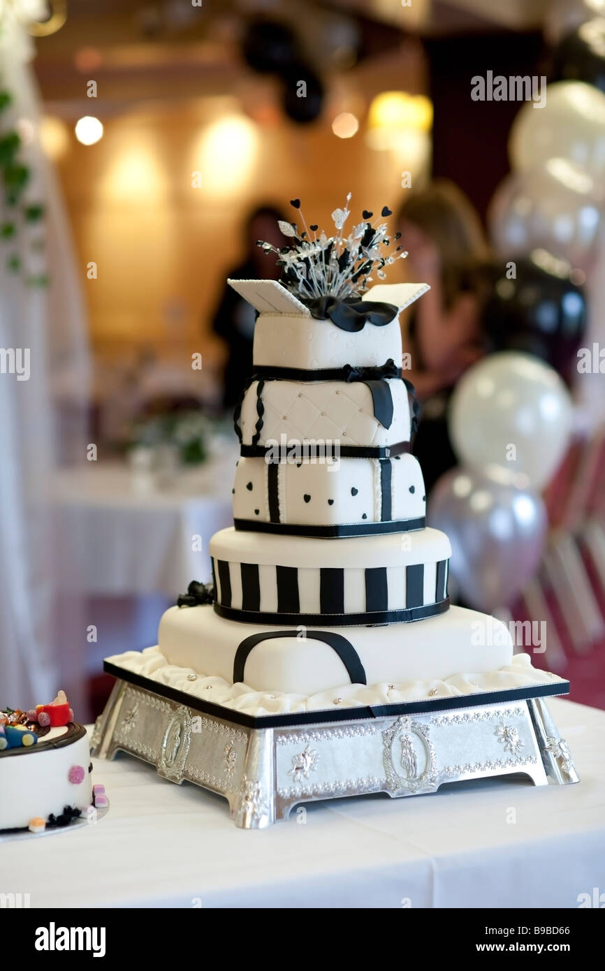 A 5 Layer Wedding Cake On A Table At A Wedding Reception Stock Photo