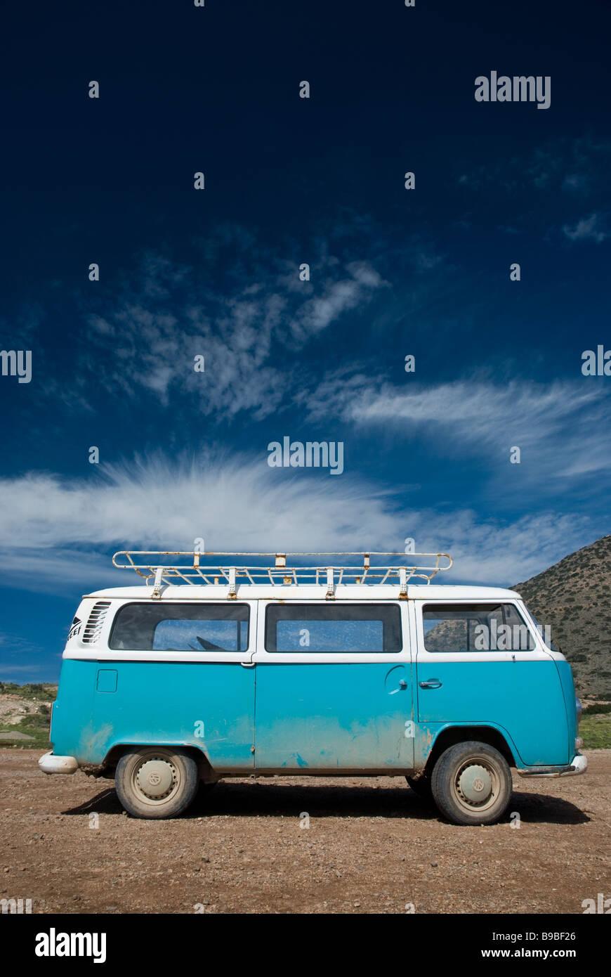 A Volkswagen Kombi van parked at Boilers surf break on Cap Rihr in Morocco. - Stock Image
