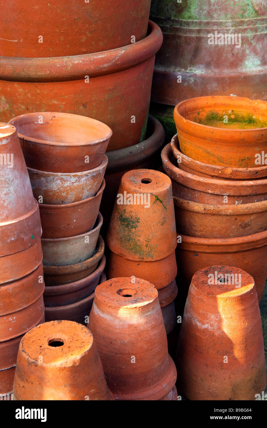 Alamy & A close up view of stacks of old clay flower pots Stock Photo ...