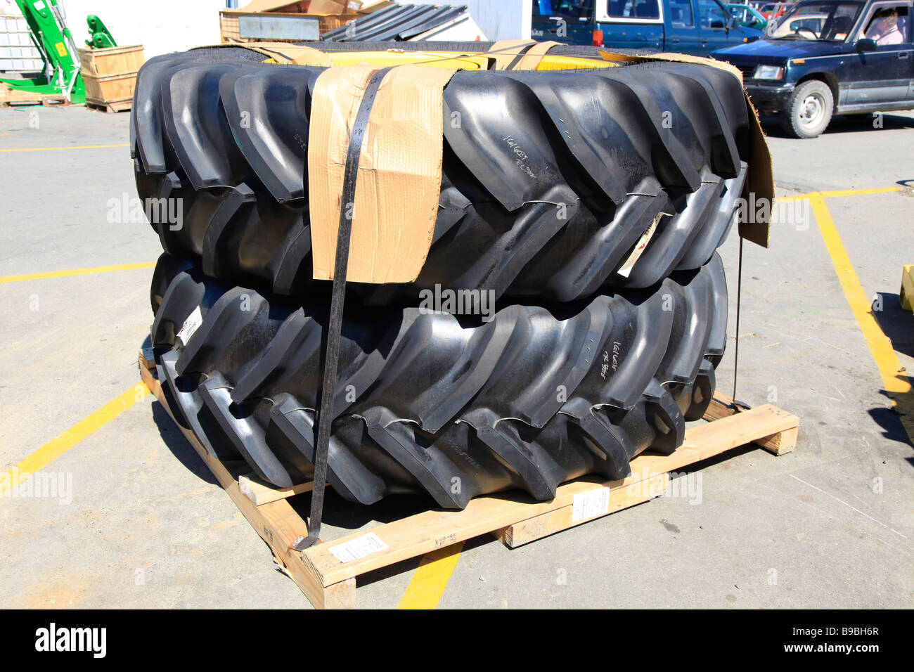 a pair of tractor tyres on pallet,Ashburton,Mid Canterbury,South Island,New Zealand - Stock Image