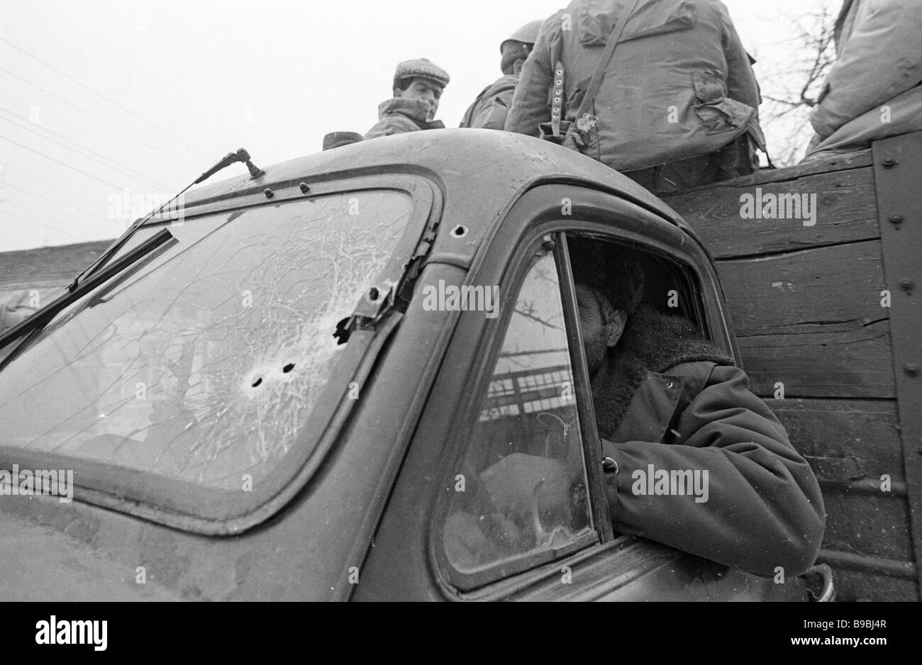A bullet riddled truck at which Azeri paramilitaries shot during the Armenian Azeri armed conflict Stock Photo