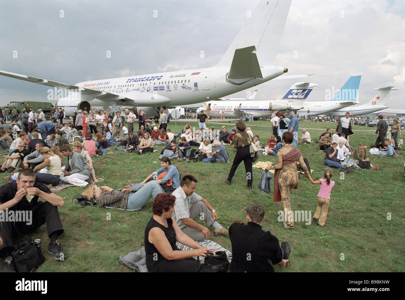 Guests rest near the aircraft presented at the sixth international aviation and space salon MAKS 2003 - Stock Image