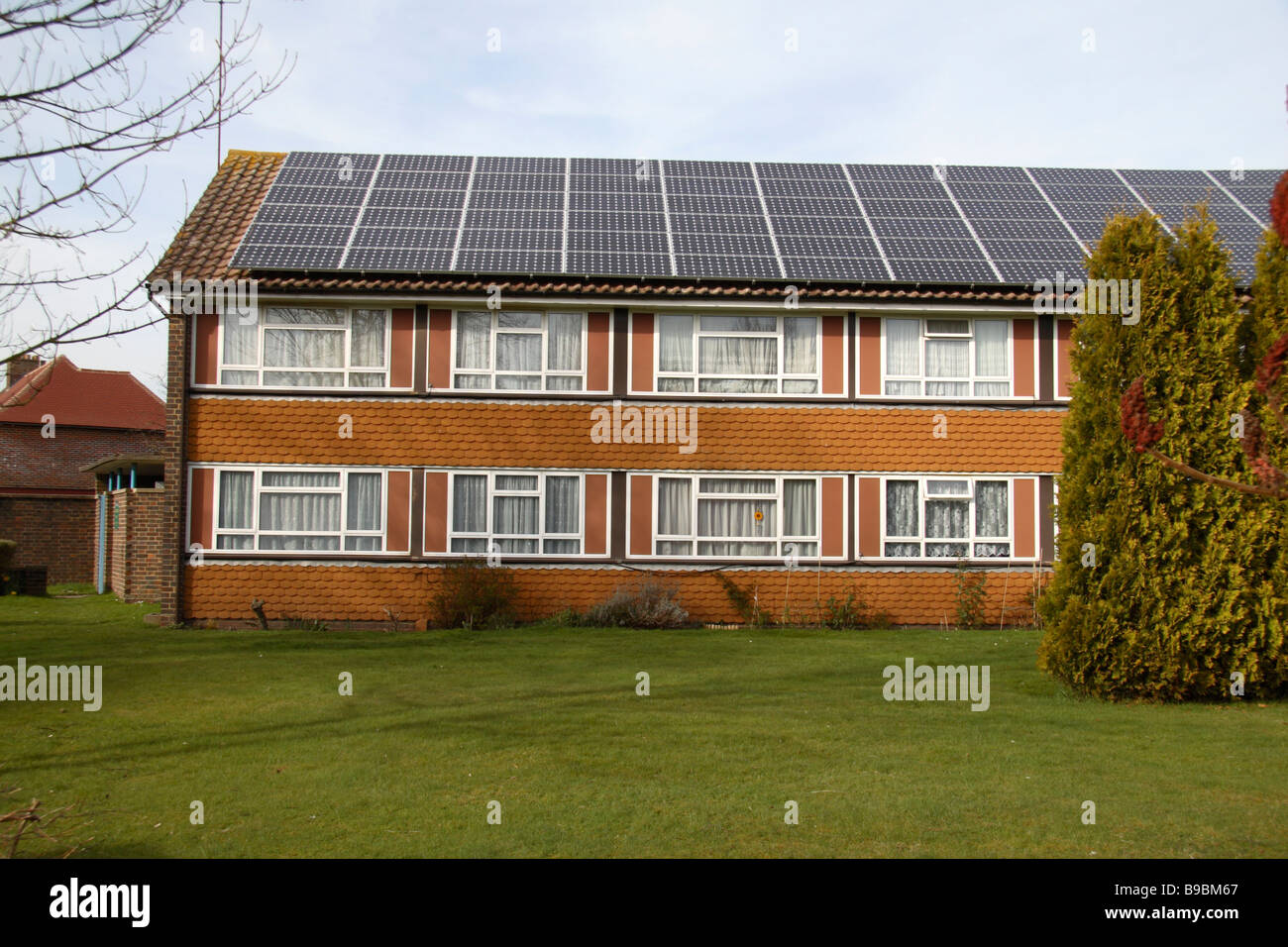 Solar panels on the roof of a residential home in south west London. - Stock Image