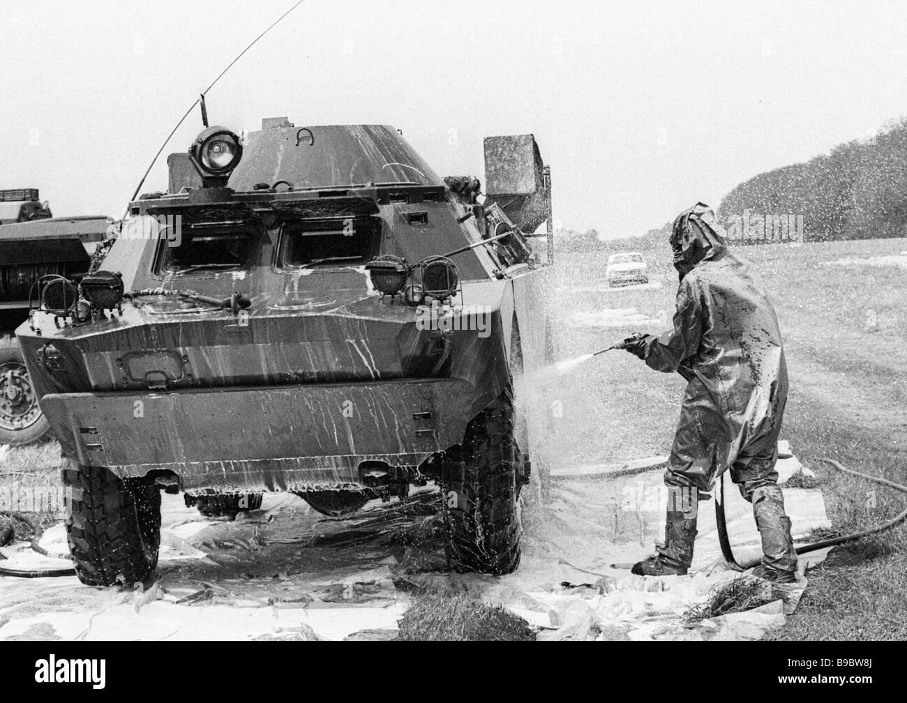 Military hardware working in the Chernobyl disaster area undergoes decontamination at the special point - Stock Image