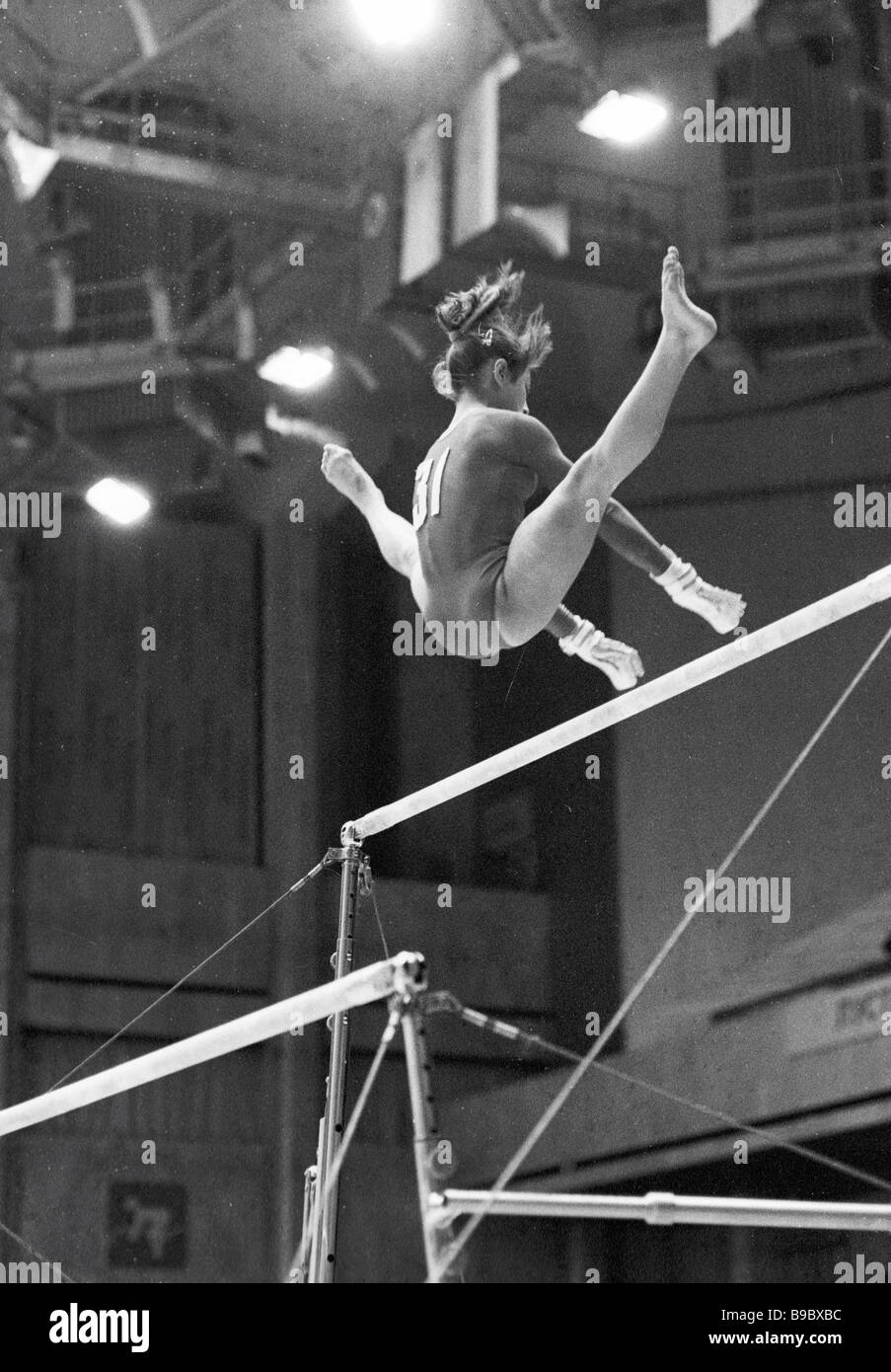 European and World 1985 all around champion Elena Shushunova in a top difficulty P bars exercises - Stock Image
