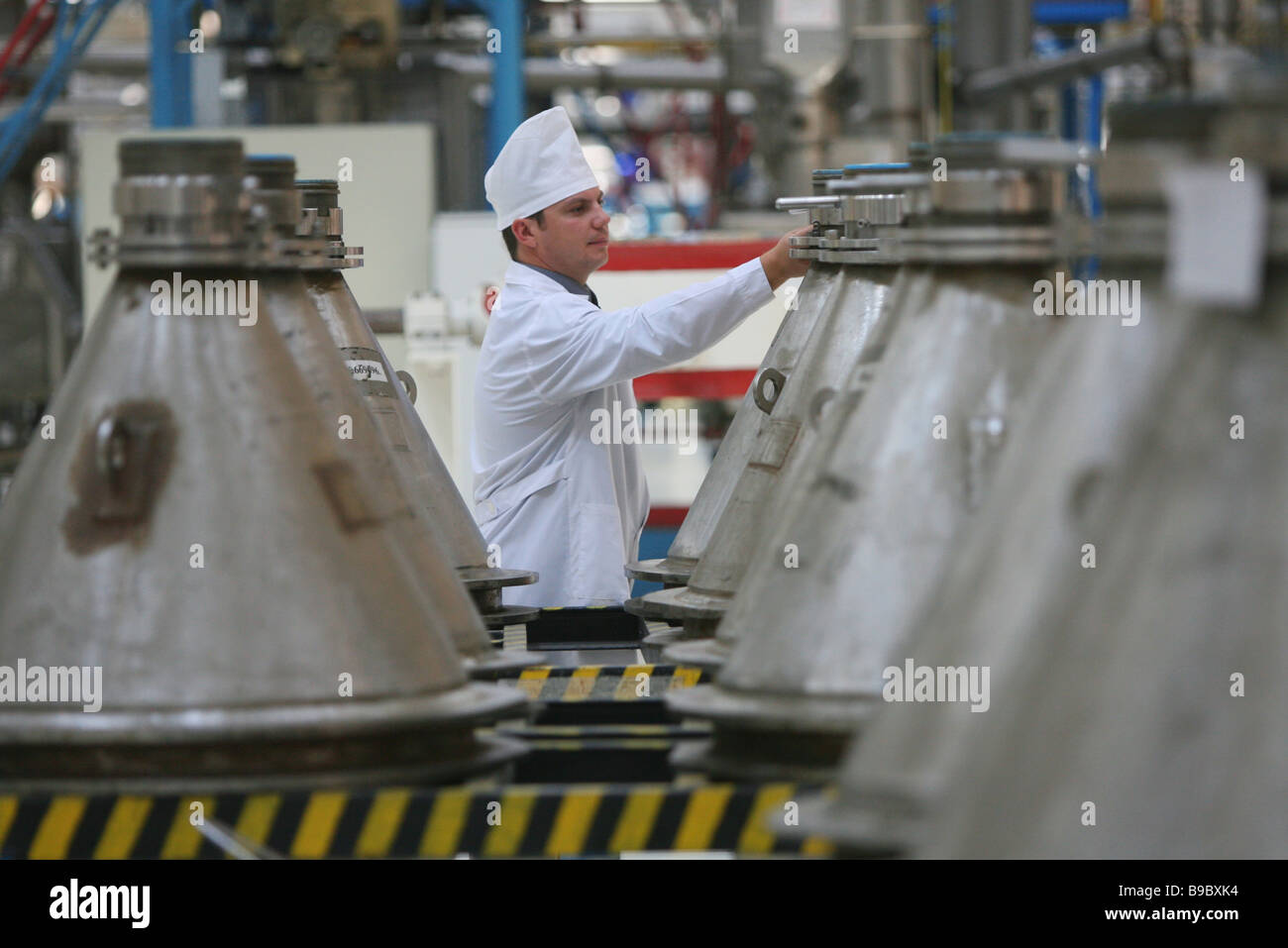 Uranium dioxide powder bi conic containers in the Novosibirsk Chemical Concentrate Works power reactor fuel production - Stock Image