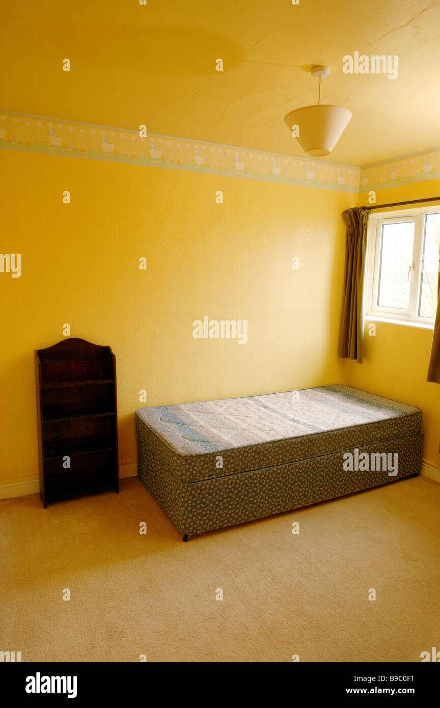 An Empty Bedroom With Yellow Walls And Bed In The Corner Under A Window Old Style Curtains