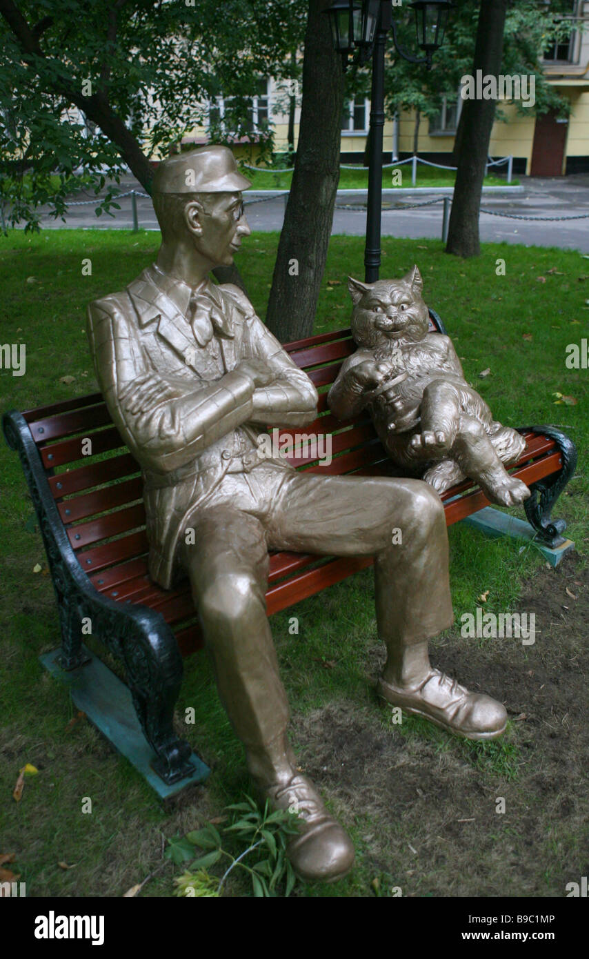 A monument to the characters of Mikhail Bulgakov s novel Master and Margarita in Moscow - Stock Image