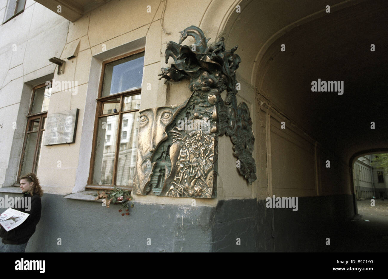 A bronze composition featuring characters from Mikhail Bulgakov s novel Master and Margarita mounted on the facade - Stock Image