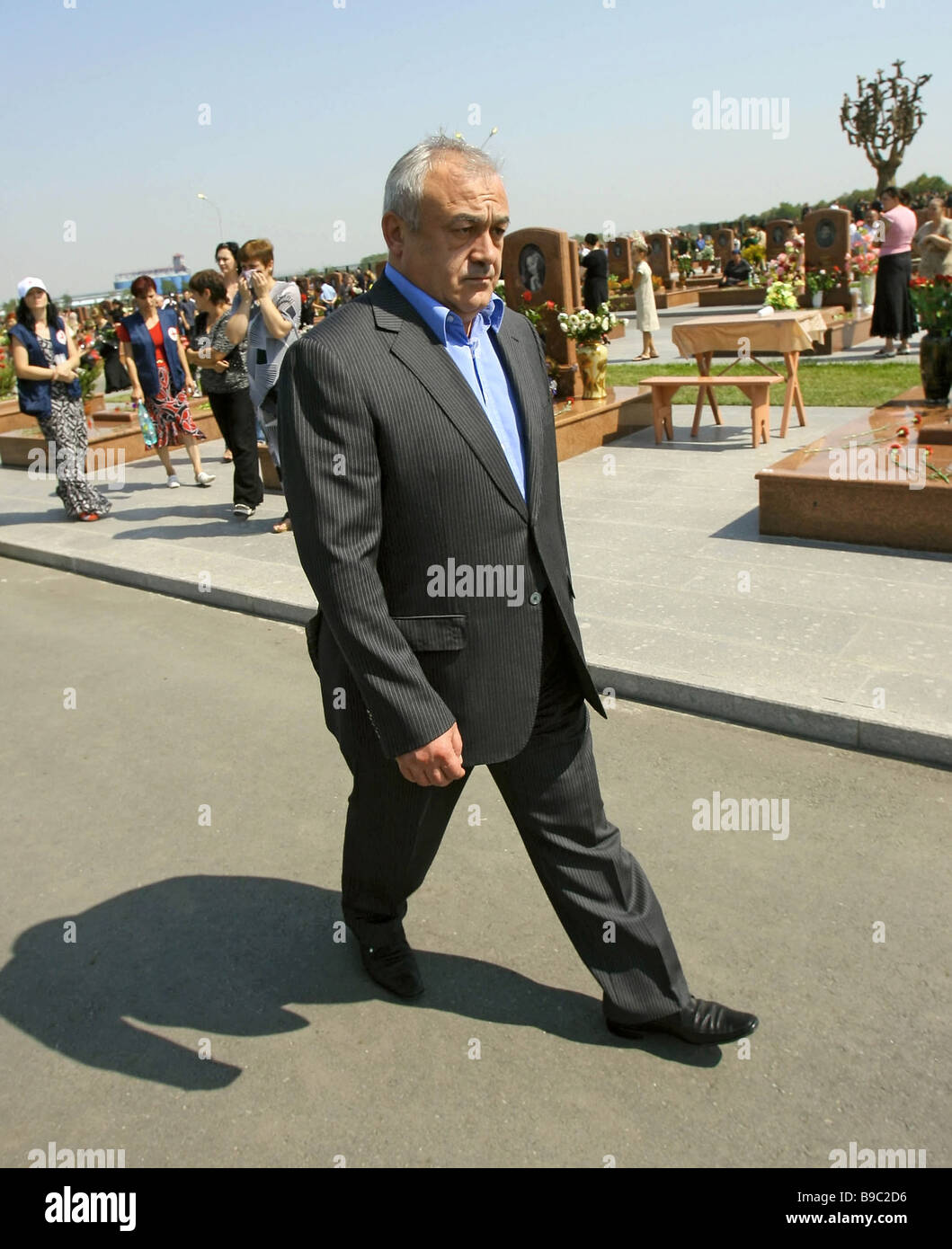 North Ossetian President Teimuraz Mamsurov at Beslan cemetery where victims of September 2004 school tragedy in - Stock Image