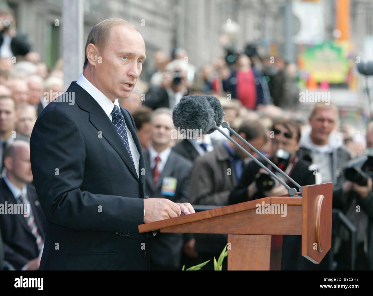 Russian President Vladimir Putin in the foreground speaking at the Moscow City Day celebrations - Stock Image