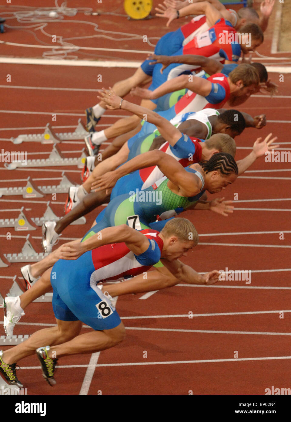 Start of the men s 100 meter dash at the Russia U S track and field tournament at the Luzhniki Stadium in Moscow - Stock Image