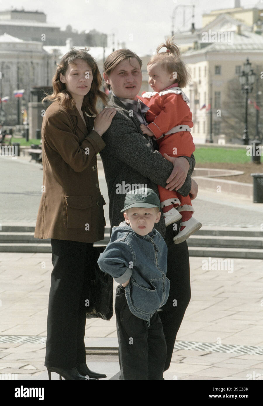 A young family promenades in Moscow - Stock Image