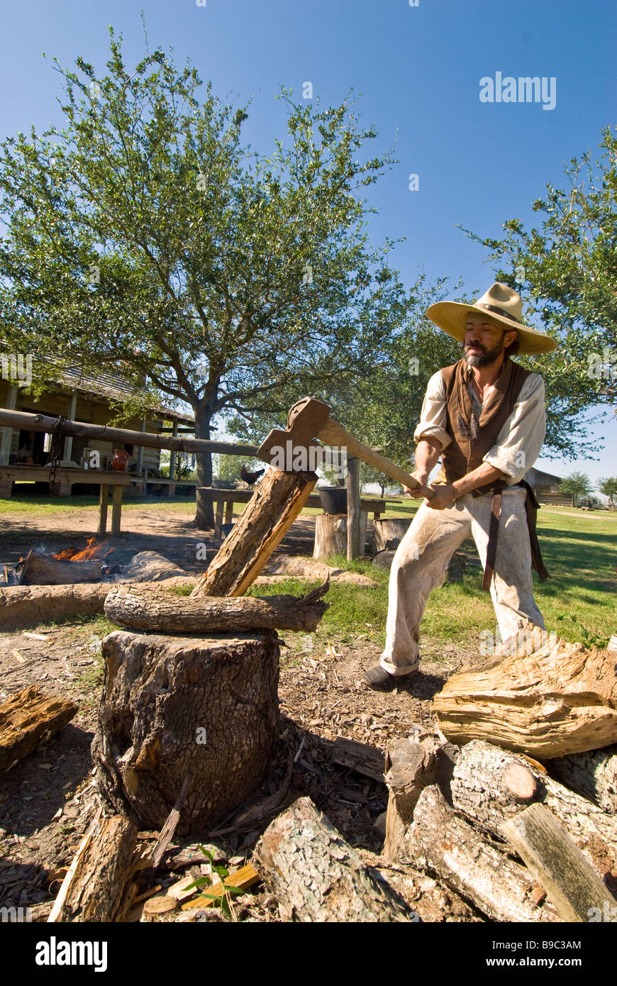 Settler chopping wood 1830s Jones Stock Farm George Ranch Historical Park Houston texas tx tourist attraction - Stock Image