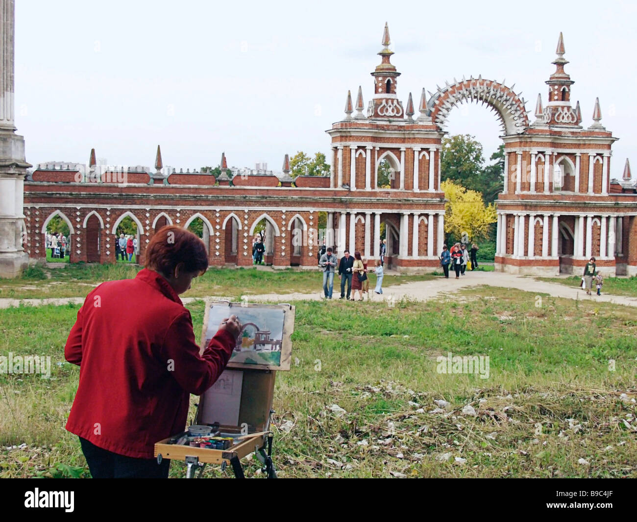 Young artist painting from nature the garner gates history and architecture preserve Tsaritsyno Stock Photo