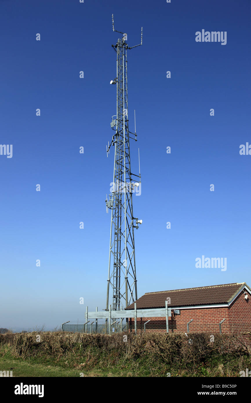 Tele communications mast with numerous Satellite dishes bolted onto the metal frame - Stock Image