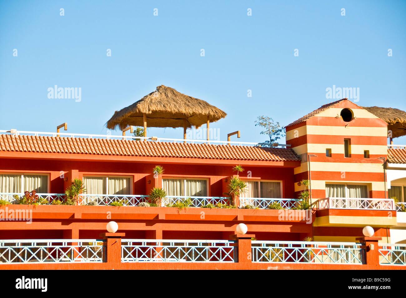 Porto Marina Resort and Spa fanrasy hotel building architecture bright colors red Egypt Mediterranean North Coast - Stock Image