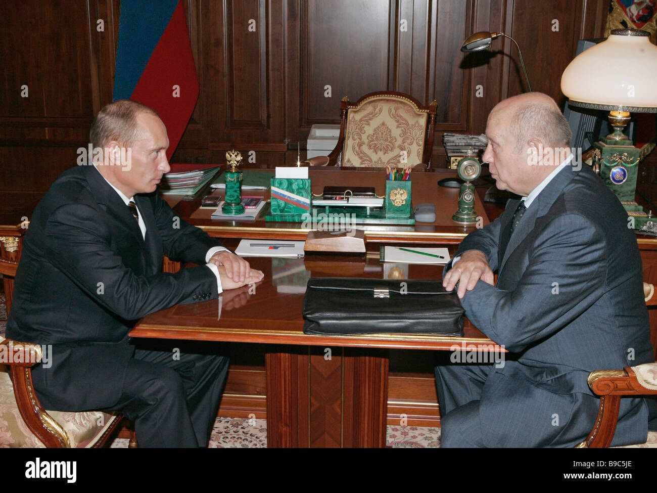 Russian President Vladimir Putin and Prime Minister of the Russian Federation Mikhail Fradkov left to right meeting Stock Photo