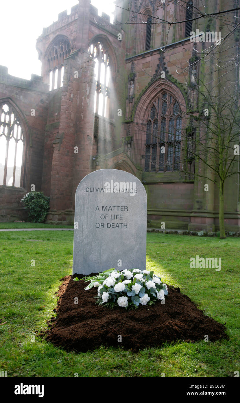 A mock gravestone erected by the Christian Aid charity to symbolize the people killed by the effects of climate Stock Photo