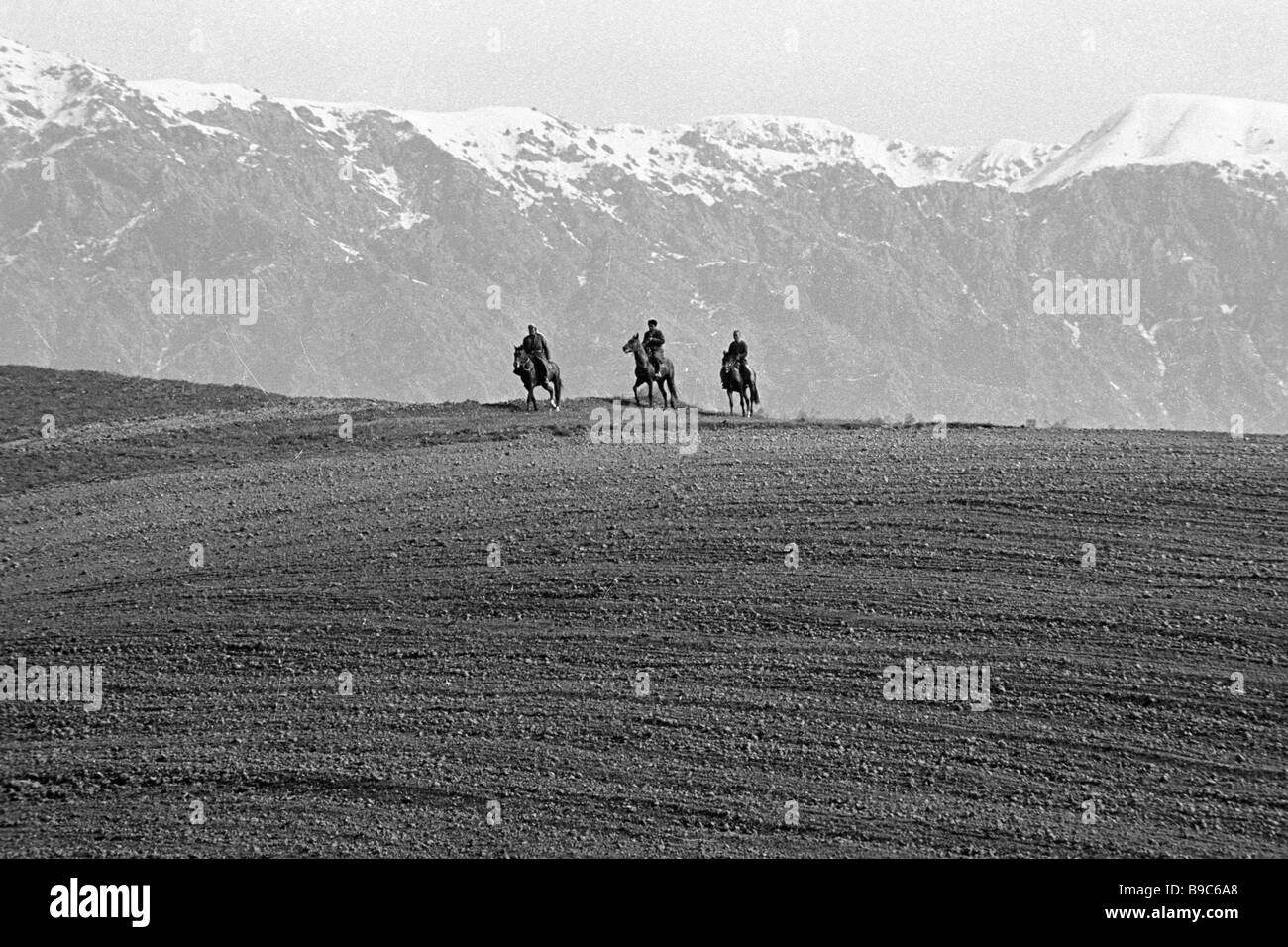 Horsemen in foothills of the Gissar range - Stock Image