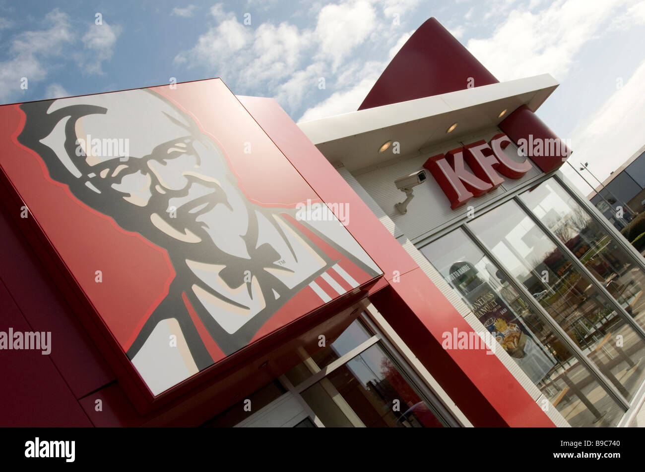 Kentucky fried chicken colonel sanders southern restaurant fast junk food bargain bucket kfc outlet pepsico pepsi - Stock Image
