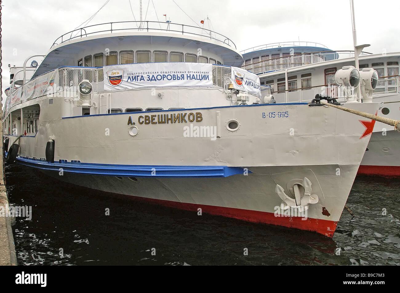 The river boat Alexander Sveshnikov moving along the Volga River and making stops in major cities Aboard this shipStock Photo